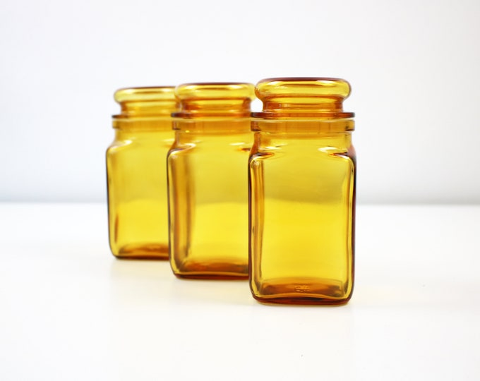 Set of 3 1970s French amber glass storage apothecary jar square with flat topped bubble lid