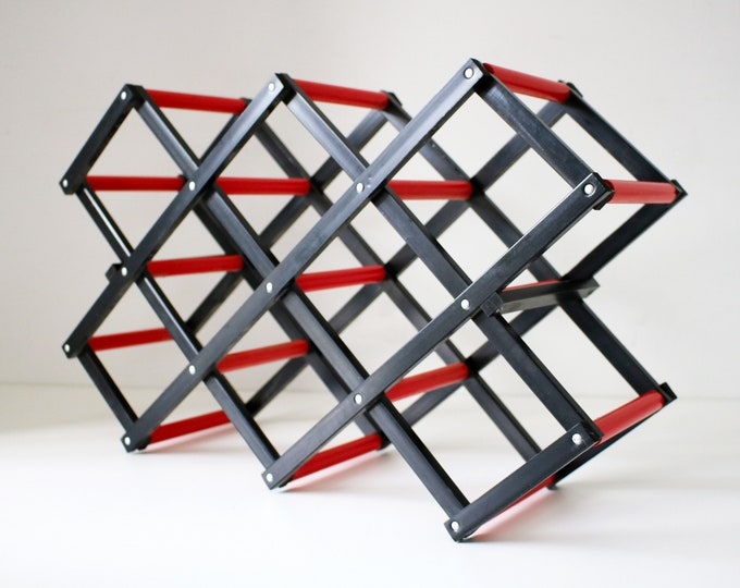 Fab retro folding accordian wine rack in red and black plastic. 80s Executive Yuppie feel.