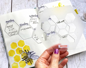 Honeycomb Hexagon bullet journaling stencil creates fun layouts. Hop over here to get it.