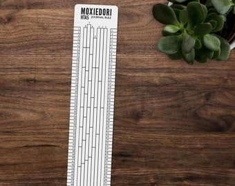 A5 Ruler for Hobonichi counts the box grid and evenly divides the journal page. Get it over here.