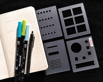 4 Piece Essential bullet journaling mini stencil set makes monthly, tracker, weekly and daily layout elements quickly. Get it here.