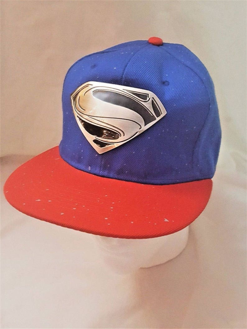 e1ac8b119950a DC Superman Silver w  Black Logo on Red Trim Snap-back Blue