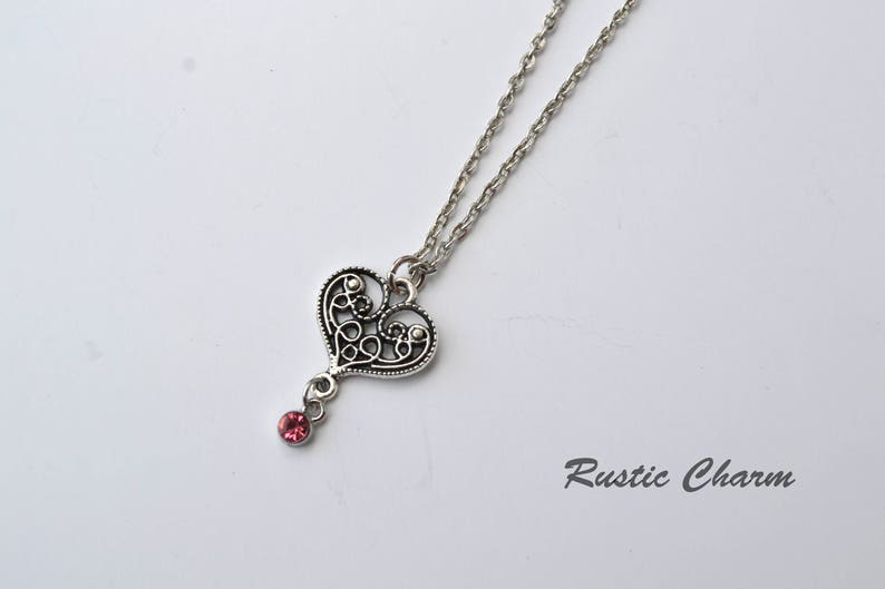 Personalized birthstone crystal heart pendant necklace in image 0