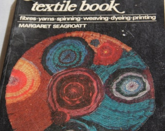 A BASIC TEXTILE BOOK fibres yarns spinning weaving dyeing printing Margaret Seagroat 1975 vintage craft book textile book vintage book
