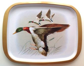 A 1960's flying ducks tin tray