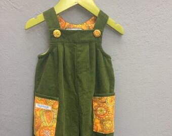 Green corduroy overalls with orange retro pockets, size 74 / 9 months
