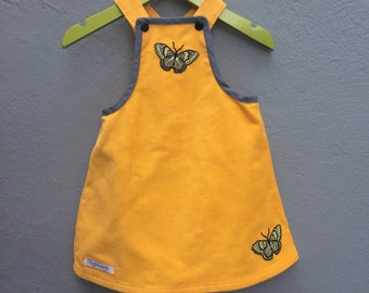Yellow corduroy dress with butterfly appliqué, size 74 / 9 months