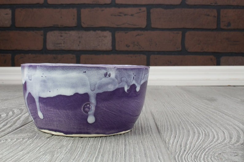 Purple ceramic bowl with dripping white and paw print of purrfection SALE item