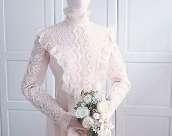 1970s majestic long sleeves ivory beaded wedding gown