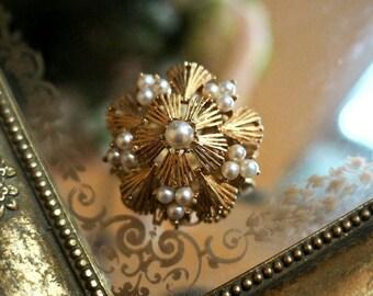 Vintage golden floral brooch