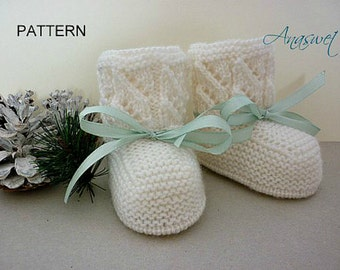 Pattern baby booties in white.