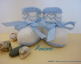 Knitting patterns booties in blue and white.P034.