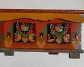Miniature blanket chest dollhouse sized with red folk motif