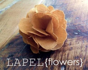 lapel flower in mustard linen