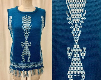 e59db30f276 1950s-1960s Sweater Vest   Teal Blue and White Intarsia Knit Tank   Aztec  or Mayan God   Tasseled Trim   Modern Size Medium to Large