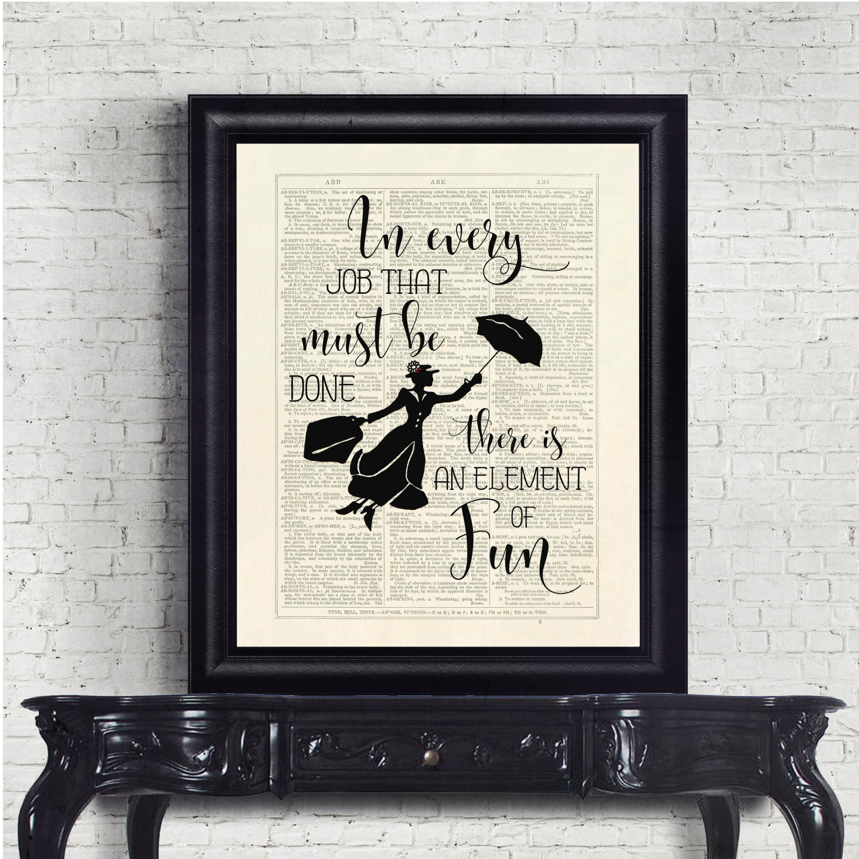 framed marry poppins quote over news print