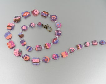Just Peachy, Purple and Pink, and on the Dot necklace in polymer clay