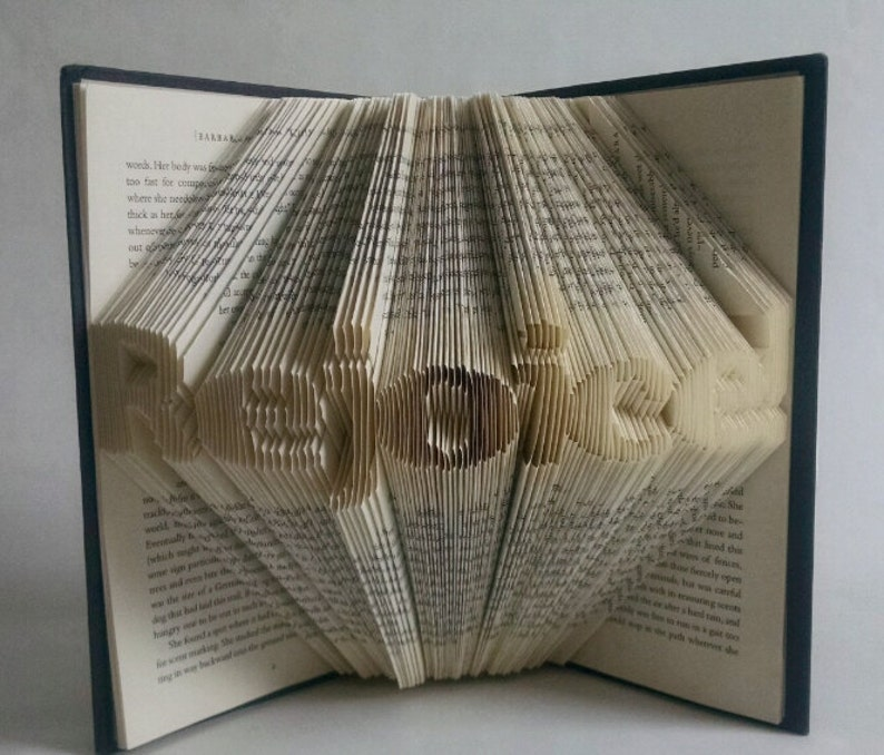 Folded Book Art Featuring the word Rejoice  image 0