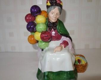 Leonardo the balloon seller old woman