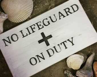 Rustic distressed no lifeguard on duty wood sign