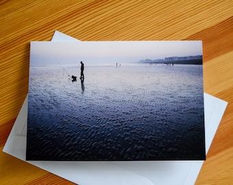Fisherman at low tide