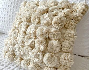 Boho cream cushion cover with pom poms