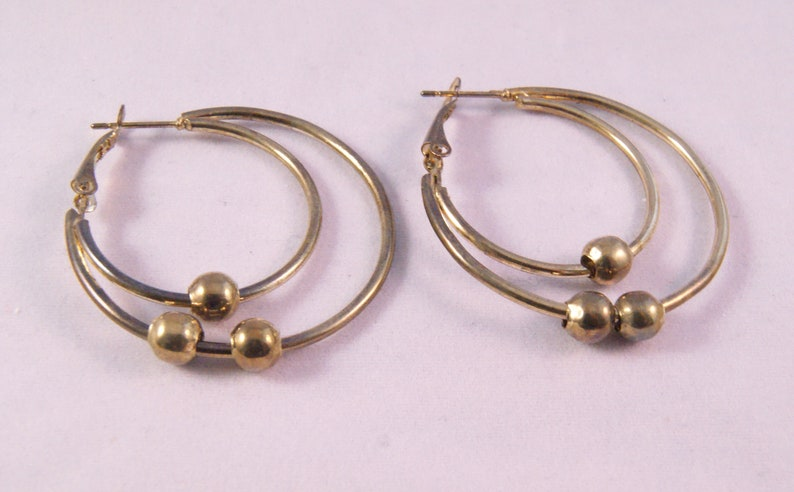 Gold tone pierced double hoop earrings with beads