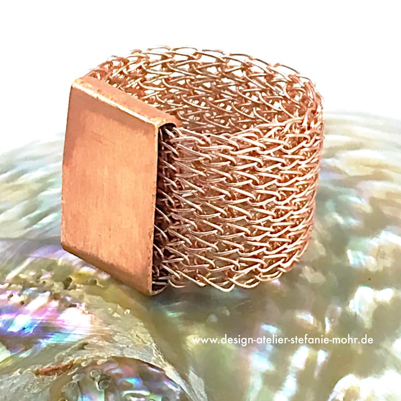 hand made rose gold coloured finger knitted RING with copper slider