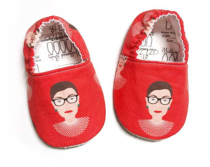 Featured listing image: Notorious RBG Moccs / Ruth Bader Ginsberg Moccs/ Mocs / Infant Moccasins / Baby Moccs / Toddler Moccasins / Toddler Slippers / Vegan Moccs