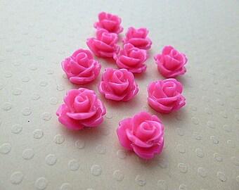 Set of 10 resin flowers pink 10mm - en-0623