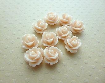 Set of 10 resin flowers peach 10 mm