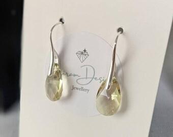Swarovski earrings, Shimmering Earring, Swarovski earrings in the UK , Silver earring, Classy Jewellery, Peridot green earrings, crystal