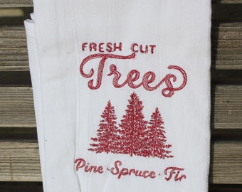 Fresh cut christmas Trees is embroidered on a white flour sack tea towel, dish towel, cotton