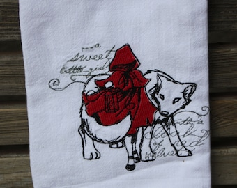 A Beautifully drawn stylized Red Riding Hood is embroidered on a white flour sack tea towel, dish towel, cotton