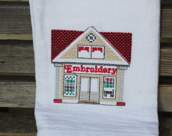 Embroidery Store embroidered on a white tea towel, dish towel, flour sack, cotton, large
