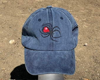 A black spider is  Embroidered on a Baseball Hat Cap, Adjustable hat, adult, dad hat, trucker hat