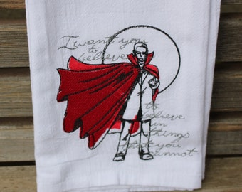 A Beautifully drawn stylized Count Dracula is embroidered on a white flour sack tea towel, dish towel, cotton
