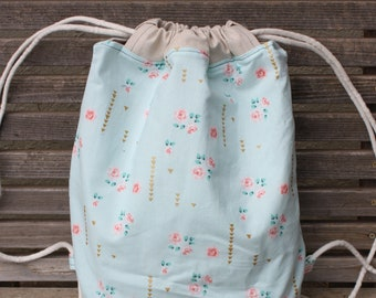Floral Roses Drawstring backpack, a fun accessory for any outfit, Canvas lined and bottom for durability, inside pocket