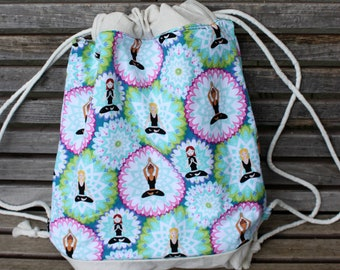 Meditation/Yoga Drawstring backpack,  a fun accessory for any outfit, Canvas lined and bottom for durability, inside pocket