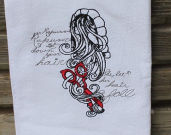 A Beautifully drawn stylized Rapunzel is embroidered on a white flour sack tea towel, dish towel, cotton