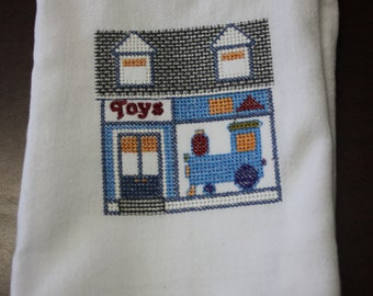 Toy Store embroidered on a white tea towel, dish towel, flour sack, cotton, large