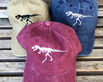 A Dinosaur skeleton  is  Embroidered on a Baseball Hat Cap, Adjustable hat, adult, dad hat, trucker hat
