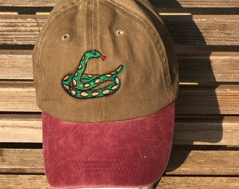 A fun snake  is  Embroidered on a Baseball Hat Cap, Adjustable hat, adult, dad hat, trucker hat