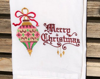 A Beautiful Christmas Ornament is embroidered on a white flour sack tea towel, dish towel, cotton