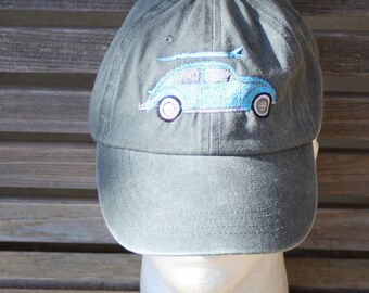 A surfboard car is  Embroidered on a Baseball Hat Cap, Adjustable hat, adult, dad hat, trucker hat