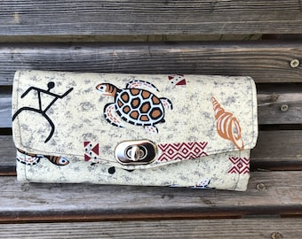 Turtle cave painting wallet, based on NCW pattern, Accordian wallet. Lots of places for necessities, handy, roomy.  Clutch and Crossbody