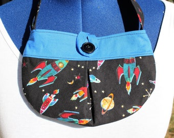 Soar to the stars with this Little girl pleated retro rocket fabric purse  Small bag, child sized.  Lined in Coordinated cotton