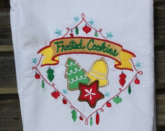 Frosted christmas Cookie is embroidered on a white flour sack tea towel, dish towel, cotton