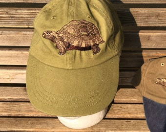 A large turtle/ tortoise is  Embroidered on a Baseball Hat Cap, Adjustable hat, adult, dad hat, trucker hat