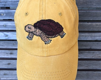 A turtle/ tortoise is  Embroidered on a Baseball Hat Cap, Adjustable hat, adult, dad hat, trucker hat